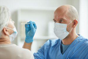 Doctor Taking Nasal Swab